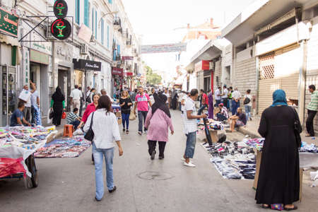 Local street market at the heart of the city of Tunis where the residents, come for great bargains for their day to day shopping Stock Photo - 17464954