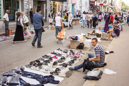 Local street market at the heart of the city of Tunis where the residents, come for great bargains for their day to day shopping Stock Photo - 17464958