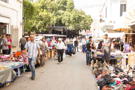 Local street market at the heart of the city of Tunis where the residents, come for great bargains for their day to day shopping Stock Photo - 17464936