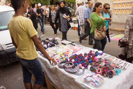 Local street market at the heart of the city of Tunis where the residents, come for great bargains for their day to day shopping Stock Photo - 17464967