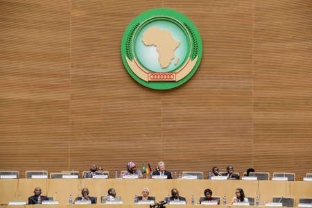 ababa: Addis Ababa, Ethiopia – March 18: German President Joachim Gauck takes his designated seat among AU deligates at the African Union Commission Head Quarters meeting hall in Addis Ababa, Ethiopia on March 18, 2013