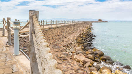 shores: An walkway fenced with rope along the shores of the Red sea near Djibouti port Stock Photo
