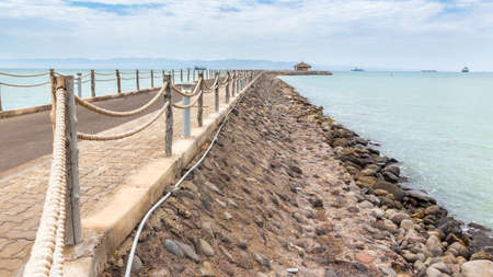 An walkway fenced with rope along the shores of the Red sea near Djibouti port Stock Photo