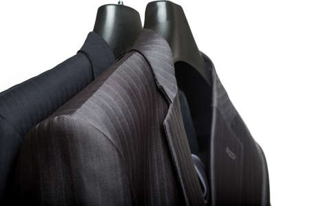 suit coat: A close-up shot of an elegant formal mens suit with a tie