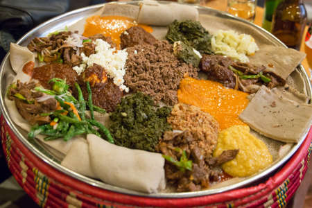 ethiopian: Traditional Ethiopian Food, Several types of stew and meat served on Injera Stock Photo