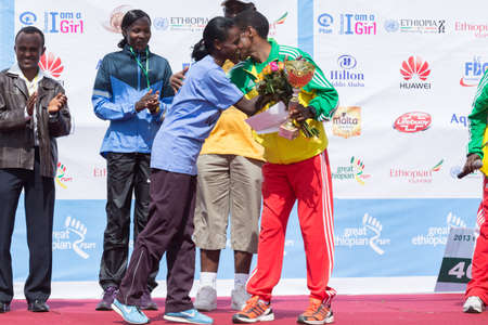 World renowned athlete Haile Gebrselassie greets the 13th Edition Great Ethiopian Run women's race winners on the 24th of November 2013in Addis Ababa, Ethiopia