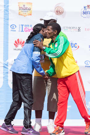haile: World renowned athlete Haile Gebrselassie greets 2013 NY Marathon winner Priscah Jeptoo on stage at the 13th Edition Great Ethiopian Run, 24th of November 2013 in Addis Ababa, Ethiopia  Editorial