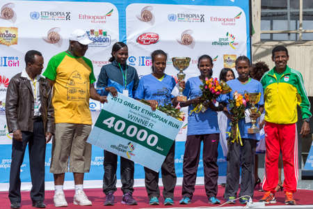 The winners of the 13th Edition Great Ethiopian Run women's race on stage with Haile Gebrselassie on the 24th of November 2013in Addis Ababa, Ethiopia  Editorial