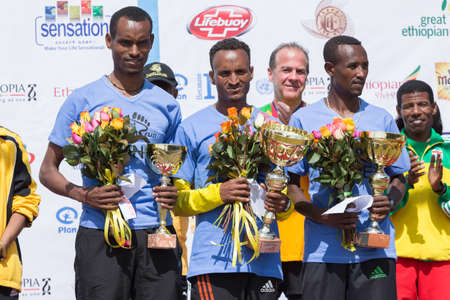 The winners of the 13th Edition Great Ethiopian Run on stage with Haile Gebrselassie on the 24th of November 2013in Addis Ababa, Ethiopia  Editorial