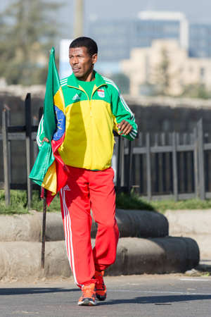 haile: Addis Ababa, Ethiopia - November 24  World renowned athlete Haile Gebrselassie holding the Ethiopian flag at the 13th Edition Ethiopian Great Run, 24th of November 2013 in Addis Ababa, Ethiopia