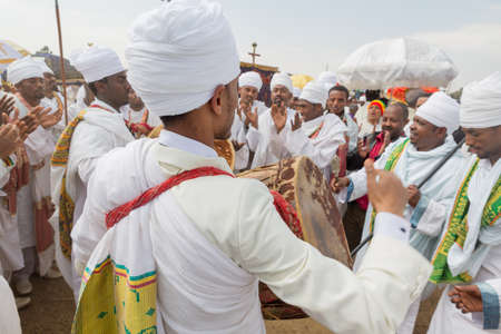 Clergymen sing and chant with kebero, a traditional drum made out of animal hide, while accompanying the Tabot, a model of the arc of covenant, during a colorful procession which is part of Timket celebrations of Epiphany, on January 19, 2014 in Addis Aba Editorial