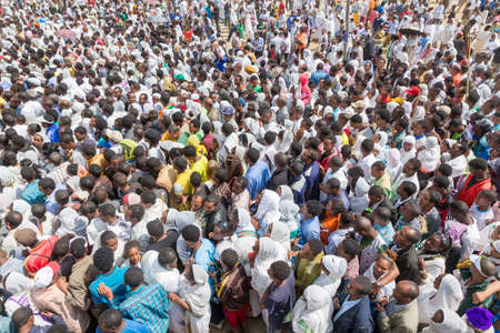 A large crowd accompany the Tabot, a model of the arc of covenant, during a colorful procession which is part of Timket celebrations of Epiphany, on January 19, 2014 in Addis Ababa. Stock Photo - 25142661