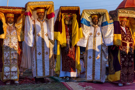 Priests carry the Tabot, a model of the Arc of Covenant, during a colorful procession of Timket celebrations of Epiphany, commemorating the baptism of Jesus, on January 18, 2014 in Addis Ababa. Stock Photo - 25142666