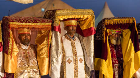 Priests carry the Tabot, a model of the Arc of Covenant, during a colorful procession of Timket celebrations of Epiphany, commemorating the baptism of Jesus, on January 18, 2014 in Addis Ababa. Stock Photo - 25142671