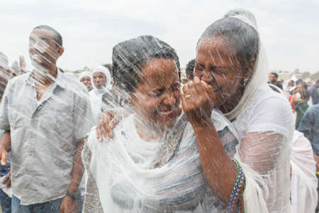 Holy water is sprayed onto the crowd attending Timket celebrations of Epiphany, commemorating the baptism of Jesus, on January 19, 2014 in Addis Ababa. Editorial