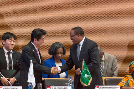 abe: H.E. Mr. Hailemariam Dessalegn, Prime Minister of the Federal Republic of Ethiopia shakes hands with H.E. Mr. Shinzo Abe, Prime Miinister of Japan on January 14, 2014, at the African Union Headquarters in Addis Ababa, Ethiopia. Editorial
