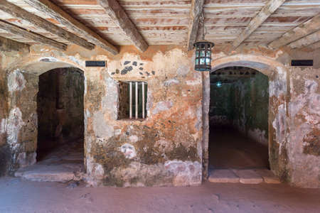 deemed: Two entrances to the cells where young virgins and slaves who weighed less than 60 kilograms deemed temporarily unfit were kept in the house of slaves on Gorée Island Editorial