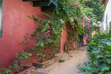 Carefully restored historical buildings from the early 19th century preserve the historical significance of Gorée Island