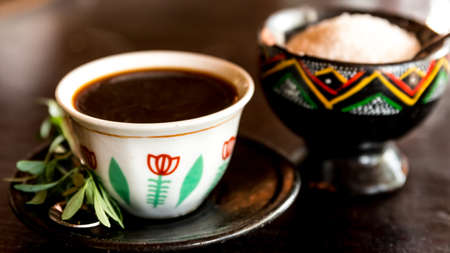rue: Traditional cup of Ethopian coffee served     with Rue leaf