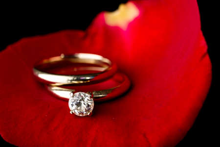 The perfect Valentines Day gift, an engagement ring on a red rose photo