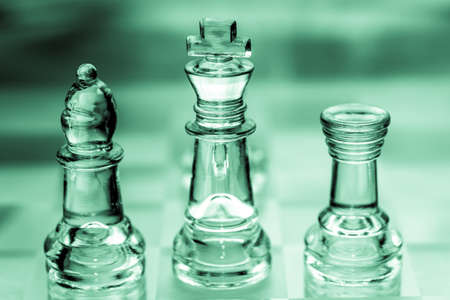 bishop, king, and rook chess pieces made out of glass