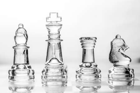bishop, king, rook and knight chess pieces made out of glass Imagens