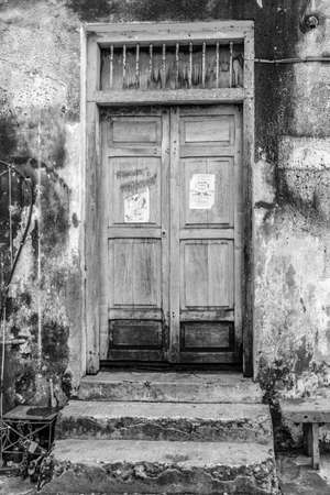 decades: An old wooden door weathered down over several decades