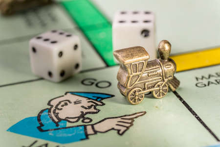 The train monopoly piece landing on go to jail space of a monopoly board Imagens - 52924462