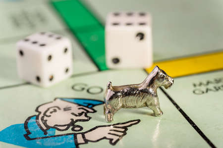 jail: The Scottie dog monopoly piece landing on go to jail space of a monopoly board