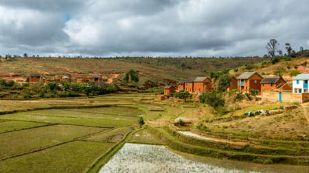 Malagasy homes build along the hills of  the central highlands of Madagascar