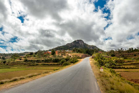 The windy road from which leads to Antananarivo through the central highlands of Madagascar Stock Photo