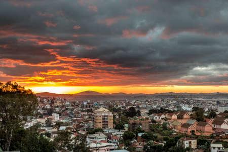 The glowing golden sun setting over Antananarivo,  the capital city of Madagascar