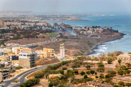 Aerial view of the city of Dakar, Senegal, showing the densely packed buildings and a highway