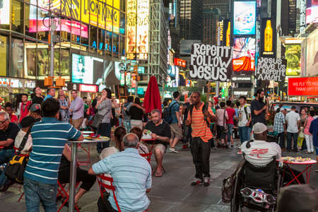 repent: New York - Sept 2014: A man carrying a slogan which states �Repent! Follow Jesus!� for the thousands of tourists roaming the streets of Times Square on Sept 7, 2014 in New York, USA.