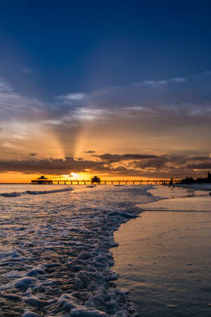The beautiful sun setting on the shores of Fort Myers Beach located on Estero Island in Florida, United States of America Imagens