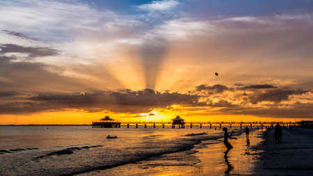 The beautiful sun setting on the shores of Fort Myers Beach located on Estero Island in Florida, United States of America Banco de Imagens