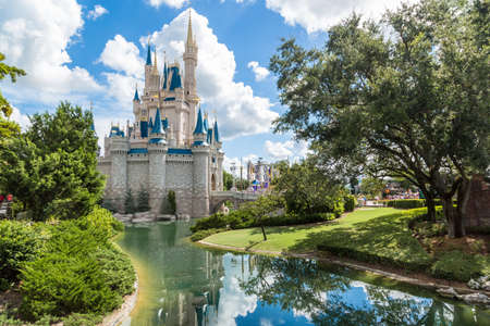 Orlando, Florida - Sept 4: The famous Disney Magic Kingdom Castle and its mirror reflection on the calm waters surrounding the castle in Orlando, Florida, on September 4, 2014