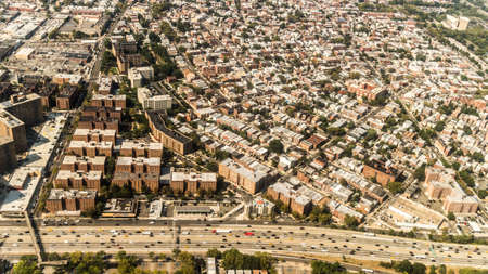 super highway: Aerial view of the Borough of Queens, New York, showing densely packed buildings and a multi-lane super highway Stock Photo