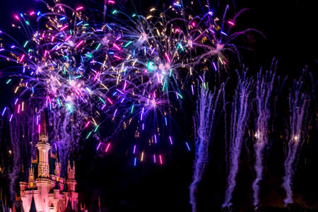 Orlando, Florida - Sept 4: The famous Wishes nighttime spectacular fireworks light up the sky at the Disney Magic Kingdom Castle in Orlando, Florida, on September 4, 2014 Imagens - 32899253