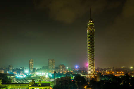 Cairo Tower colorfully lit at night in Downtown Cairo, Egypt Imagens - 33448532