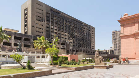 egypt revolution: The building used by the National Democratic Party of the ousted president Mubarak remains burnt and abandoned serving as a reminder of the 2011 Egypt Revolution – Cairo, Egypt – April 26, 2014.