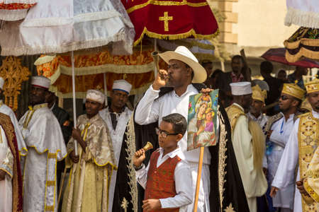 A man blows a traditional a traditional horn announcing the arrival of the tabot, representation of the arc of the covenant, during a colorful procession of the Timket (Epiphany) celebrations, on January 19, 2015 in Addis Ababa. Stock Photo - 35780534