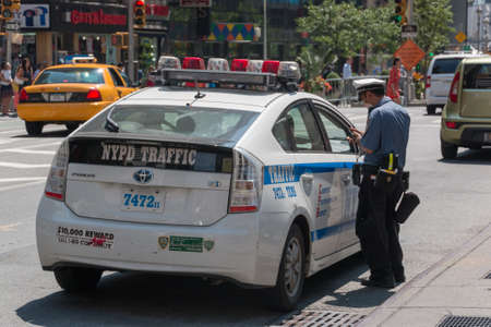 summons: New York - Aug 20: NYPD Traffic enforces parking laws in downtown Manhattan on August 20, 2014 in New York, USA