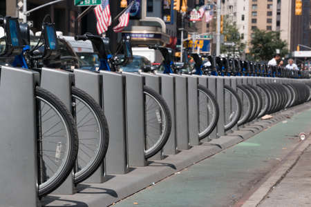 New York - Aug 20: several bicycles from city bike parked in a row waiting to be hired  in downtown New York on August 20, 2014 in New York, USA Editorial