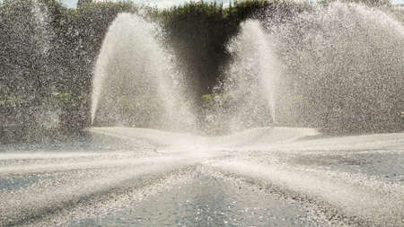 pressured: High pressured water gushing out of a pipes creating a beautiful water fountain
