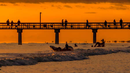 The beautiful sun setting on the shores of Fort Myers Beach located on Estero Island in Florida, United States of America 스톡 콘텐츠
