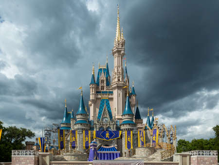 Orlando, Florida  Sept 4: The famous Disney Magic Kingdom Castle soars into the stormy clouds in Orlando, Florida, on September 4, 2014