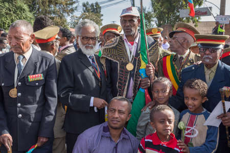 invading: Addis Ababa - Sept 2: Young children pose to take pictures with the war veterans at the 119th Anniversary Celebrations of the Ethiopian Army's victory over the invading Italian forces in the 1896 battle of Adwa. September 2, 2015, Addis Ababa, Ethiopia.