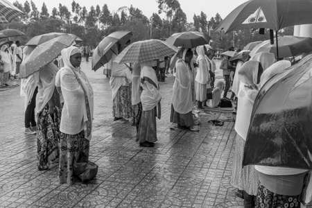 bole: Addis Ababa: April 10: Devoted Ethiopian Orthodox followers stand undeterred by the pouring rain to observe Siklet, the crucifixion of Jesus Christ, at Bole Medhane Alem Church on April 10 ,2015 in Addis Ababa, Ethiopia
