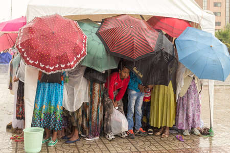 ethiopian: Addis Ababa: April 10: Devoted Ethiopian Orthodox followers stand undeterred by the pouring rain to observe Siklet, the crucifixion of Jesus Christ, at Bole Medhane Alem Church on April 10 ,2015 in Addis Ababa, Ethiopia